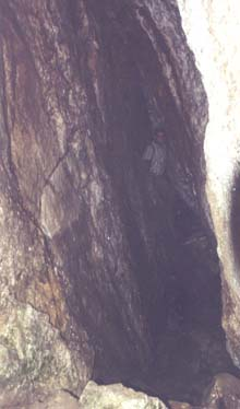 Tom inside narrow slab cave (photo by webmaster)