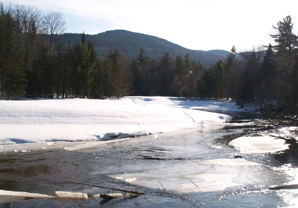 Swift River, animal tracks, and mountains (photo by Webmaster)