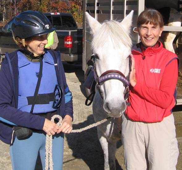 Kristin (on the right) admiring a horse at the trailhead parking area (photo by Dennis Marchand)