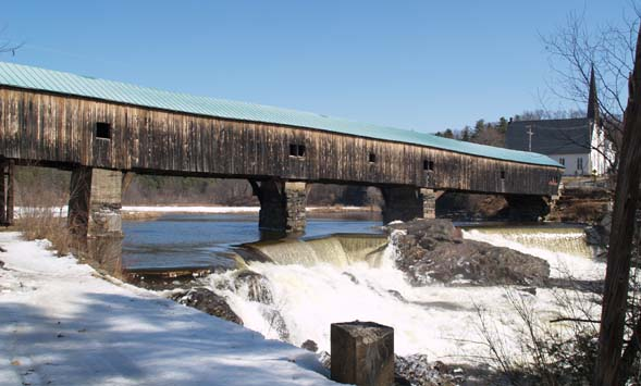 Spring photo of the Bath covered bridge and waterfalls with the snowmobile trail in the left-foreground (photo by Webmaster)